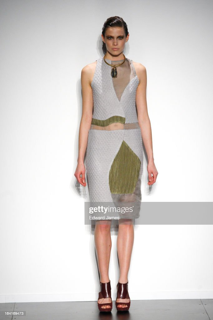 A model walks the runway at Ashtiani at David Pecaut Square on March 20, 2013 in Toronto, Canada.