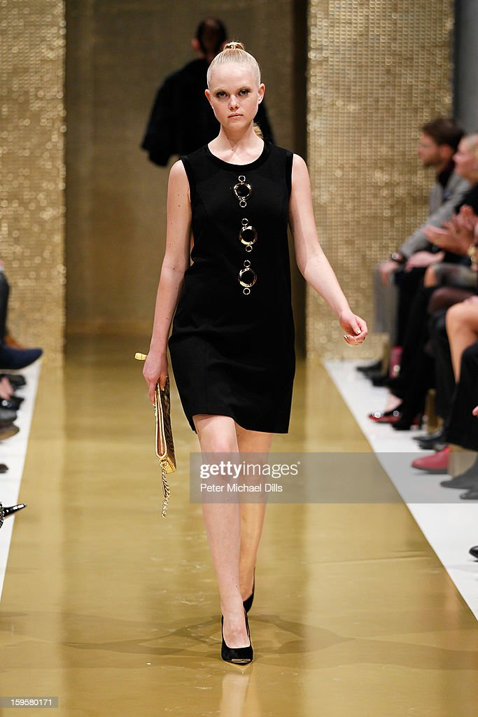 A model walks the runway at Basler Autumn/Winter 2013/14 fashion show during Mercedes-Benz Fashion Week Berlin at Hotel De Rome on January 16, 2013 in Berlin, Germany.