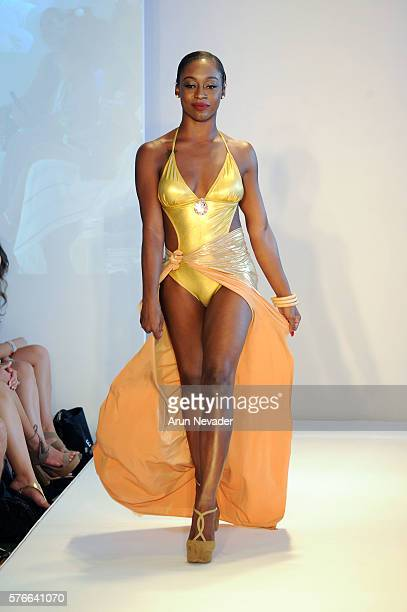 A model walks the runway at Bella Mar Swimwear at the Art Hearts Fashion Miami Swim Week At W Hotel Presented By Planet Fashion TV at W Hotel on July...