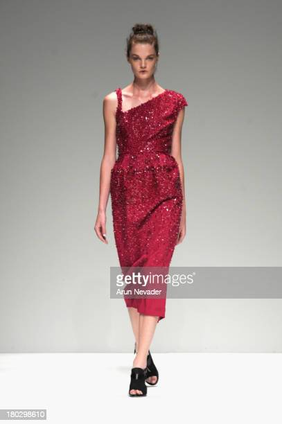 A model walks the runway at Bibhu Mohapatra fashion show during MercedesBenz Fashion Week Spring 2014 at The Studio at Lincoln Center on September 11...