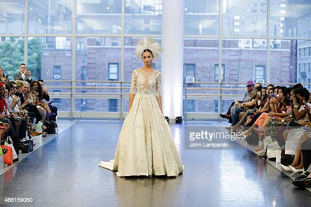 Model walks the runway at Binzario Couture Runway during Spring 2016 New York Fashion Week at Alvin Ailey American Dance Theater on September 13 2015...