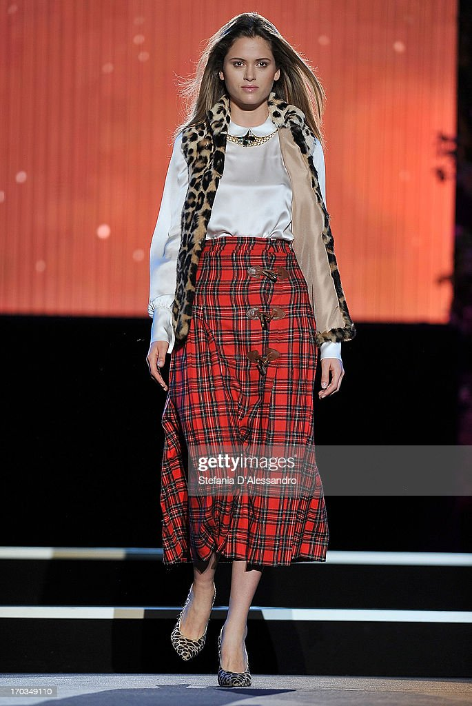 A model walks the runway at Blugirl fashion show as part of Glamour Live Show on June 11, 2013 in Milan, Italy.