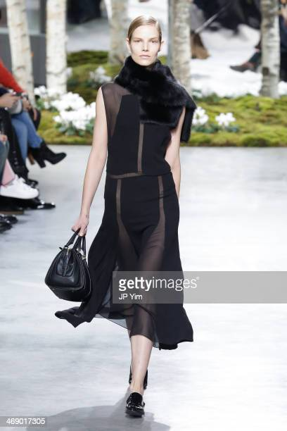 A model walks the runway at Boss Women Fall 2014 Collection during MercedesBenz Fashion Week Fall 2014 Skylight Limited on February 12 2014 in New...