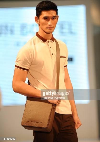 A model walks the runway at Braun Buffel show during Ciputra World Fashion Week on September 21 2013 in Surabaya Indonesia