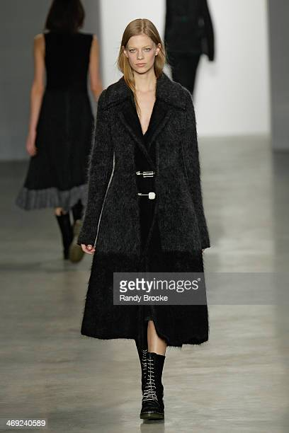 Model walks the runway at Calvin Klein Collection during MercedesBenz Fashion Week Fall 2014 at Spring Studios on February 13 2014 in New York City