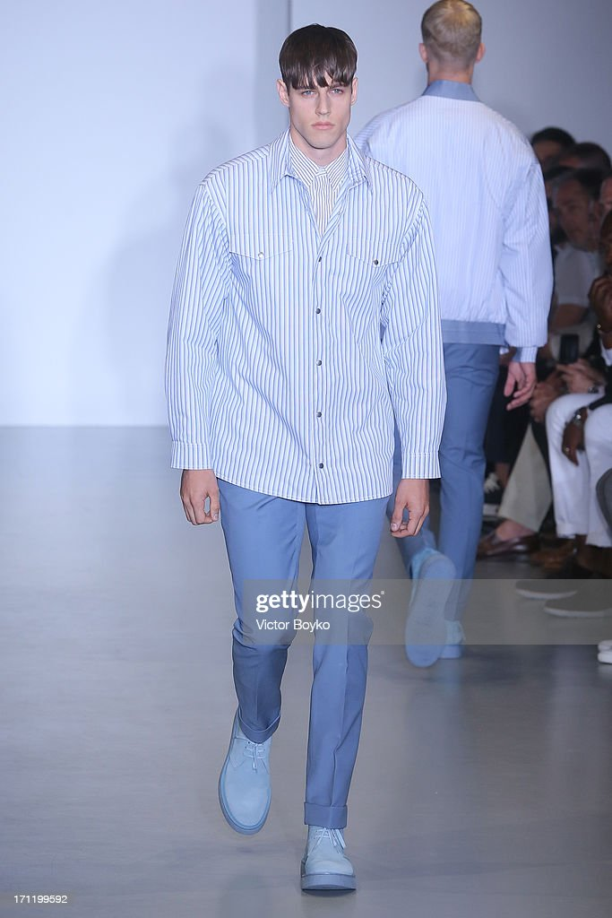 A model walks the runway at Calvin Klein Collection show during Milan Menswear Fashion Week Spring Summer 2014 on June 23, 2013 in Milan, Italy.