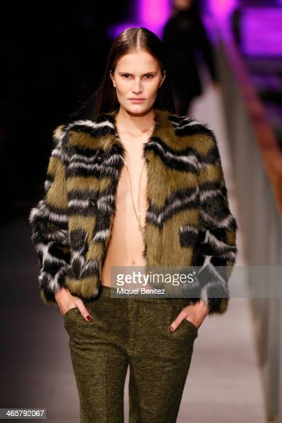 A model walks the runway at Custo Barcelona's Autumm Winter 20142015 Collection during 080 Barcelona Fashion Week at the Born Centre Cultural in...