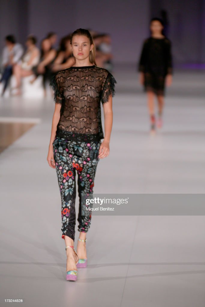 A model walks the runway at Custo Dalmau's Spring-Summer 2014 Collection during 080 Barcelona Fashion Week on July 10, 2013 in Barcelona, Spain.