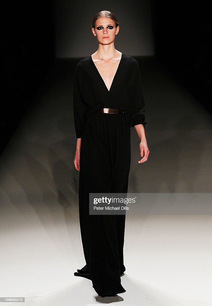 A model walks the runway at Dawid Tomaszewski Autumn/Winter 2013/14 fashion show during Mercedes-Benz Fashion Week Berlin at Brandenburg Gate on January 18, 2013 in Berlin, Germany.
