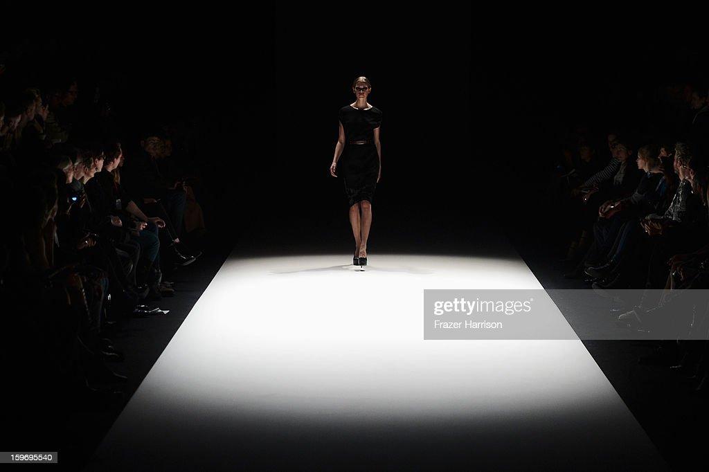 A model walks the runway at Dawid Tomaszewski Autumn/Winter 2013/14 fashion show during Mercedes-Benz Fashion Week Berlin at Brandenburg Gate on January 18, 2013 in Berlin, Germany.