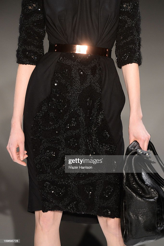 A model (detail) walks the runway at Dawid Tomaszewski Autumn/Winter 2013/14 fashion show during Mercedes-Benz Fashion Week Berlin at Brandenburg Gate on January 18, 2013 in Berlin, Germany.