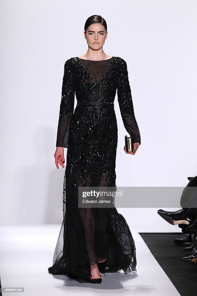A model walks the runway at Dennis Basso during Mercedes-Benz Fashion Week Fall 2014 at The Theatre at Lincoln Center on February 10, 2014 in New York City.