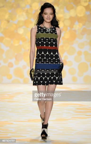 A model walks the runway at Desigual fashion show during MercedesBenz Fashion Week Fall 2014 at The Theatre at Lincoln Center on February 6 2014 in...