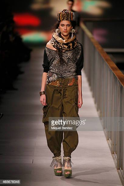 A model walks the runway at Desigual's Autumm Winter 20142015 Collection during 080 Barcelona Fashion Week at the Born Centre Cultural in Barcelona...