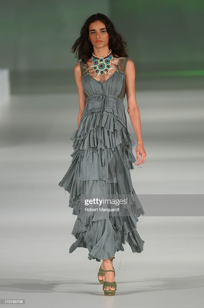 A model walks the runway at Desigual's Spring-Summer 2014 Collection 'For Everybody: Sex, Fun & Love' during 080 Barcelona Fashion Week on July 9, 2013 in Barcelona, Spain.