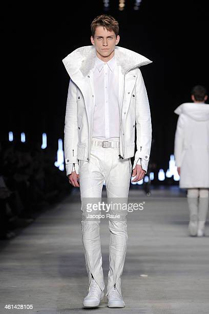 Model walks the runway at Diesel Black Gold Fashion Show during Pitti Immagine Uomo 85 on January 8 2014 in Florence Italy