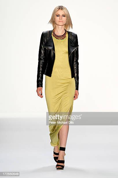 A model walks the runway at Dimitri show during MercedesBenz Fashion Week Spring/Summer 2014 at Brandenburg Gate on July 3 2013 in Berlin Germany