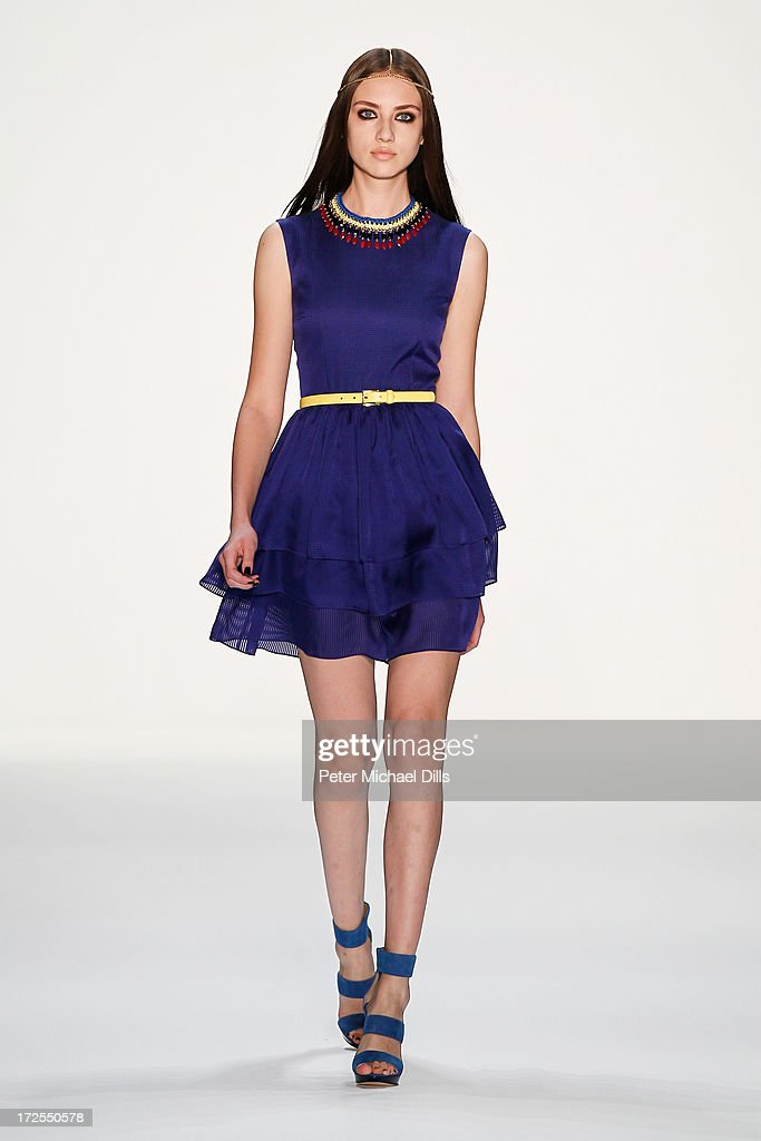 A model walks the runway at Dimitri show during Mercedes-Benz Fashion Week Spring/Summer 2014 at Brandenburg Gate on July 3, 2013 in Berlin, Germany.