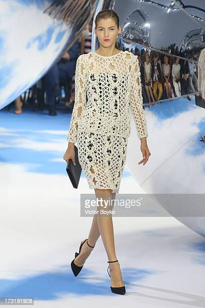 A model walks the runway at Dior A/H 20132014 show at Red Square on July 9 2013 in Moscow Russia