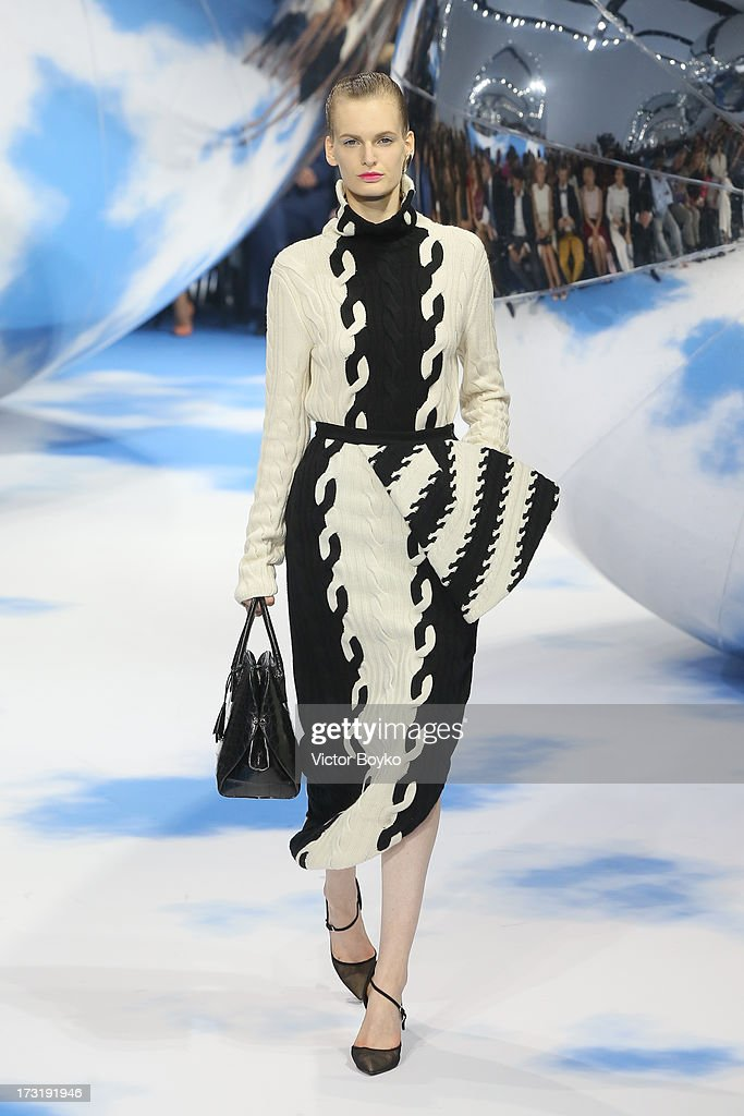 A model walks the runway at Dior A/H 2013-2014 show at Red Square on July 9, 2013 in Moscow, Russia.