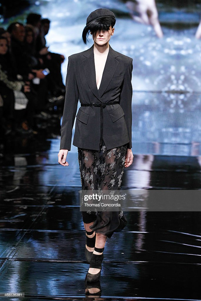 A model walks the runway at Donna Karan New York 30th Anniversary during Mercedes-Benz Fashion Week Fall 2014 at 23 Wall Street on February 10, 2014 in New York City.