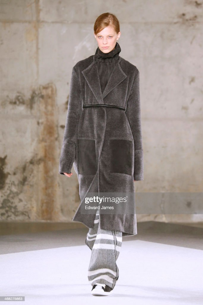 A model walks the runway at Edun during Mercedes-Benz Fashion Week Fall 2014 at Skylight Modern on February 9, 2014 in New York City.