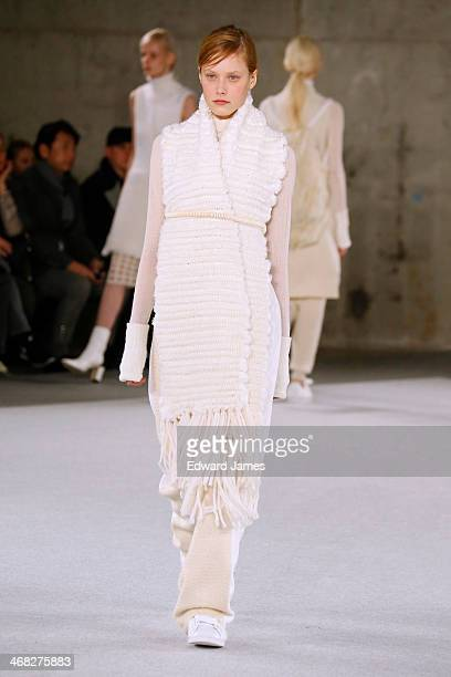 A model walks the runway at Edun during MercedesBenz Fashion Week Fall 2014 at Skylight Modern on February 9 2014 in New York City