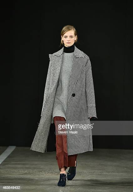A model walks the runway at Edun fashion show during MercedesBenz Fashion Week Fall 2015 at Skylight Modern on February 15 2015 in New York City