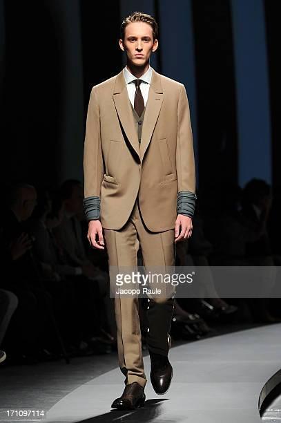 A model walks the runway at Ermenegildo Zegna show during Milan Menswear Fashion Week Spring Summer 2014 on June 22 2013 in Milan Italy