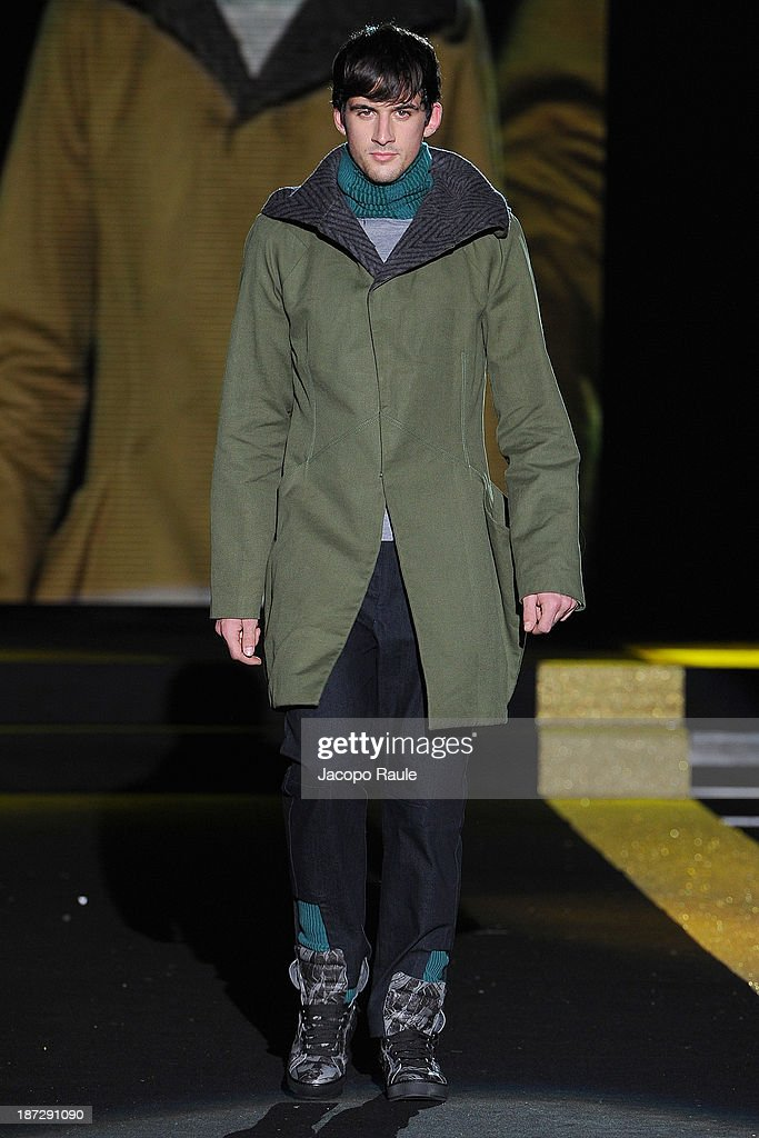 A model walks the runway at Evgeni Petkov Fashion Show during the Mittelmoda Special Edition 2013 for Lectra on November 7, 2013 in Milan, Italy.