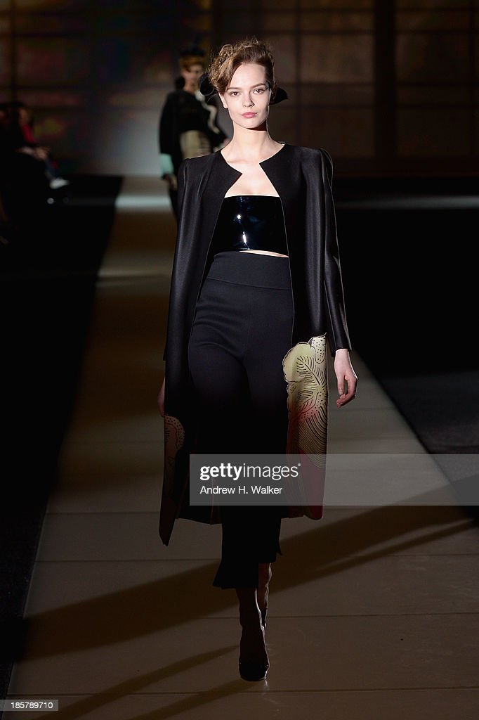 A model walks the runway at Giorgio Armani One Night Only NYC at SuperPier on October 24, 2013 in New York City.