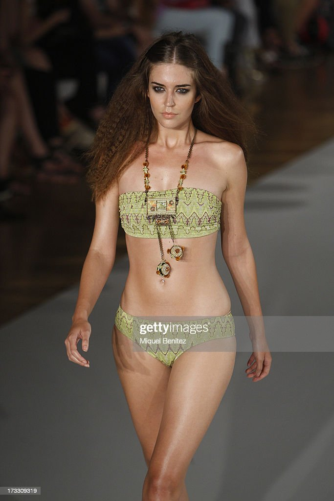A model walks the runway at Guillermina Baeza's Spring-Summer 2014 Collection during 080 Barcelona Fashion Week on July 11, 2013 in Barcelona, Spain.