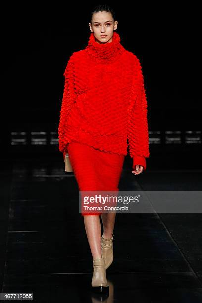 A model walks the runway at Helmut Lang during MercedesBenz Fashion Week Fall 2014>> at 545 West 22nd Street on February 7 2014 in New York City