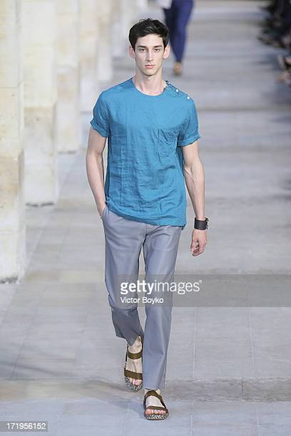 A model walks the runway at Hermes Menswear Spring/Summer 2014 Show As Part Of The Paris Fashion Week on June 29 2013 in Paris France
