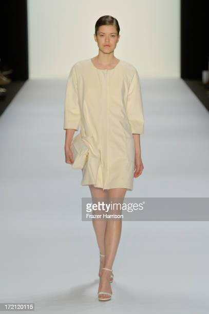 A model walks the runway at Hien Le Show during MercedesBenz Fashion Week Spring/Summer 2014 at Brandenburg Gateon July 2 2013 in Berlin Germany