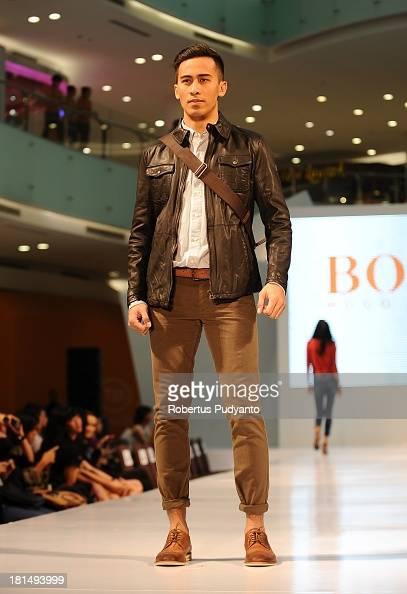 A model walks the runway at Hugo Boss fashion show during Ciputra World Fashion Week on September 21 2013 in Surabaya Indonesia