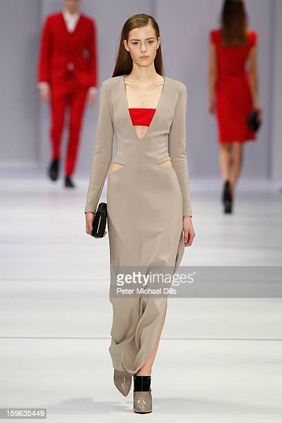 A model walks the runway at Hugo By Hugo Boss Autumn/Winter 2013/14 fashion show during MercedesBenz Fashion Week Berlin at Opernwerkstatte on...