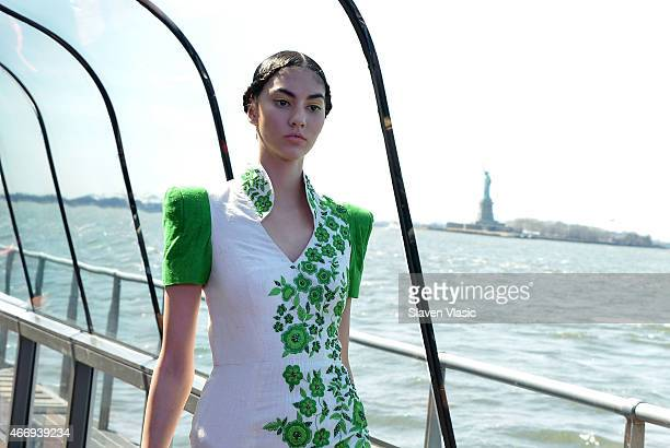A model walks the runway at J Spring Fashion Show 2015 at cruising boat on Hudson River a part of Jessica Minh Anh's series of catwalks at the most...
