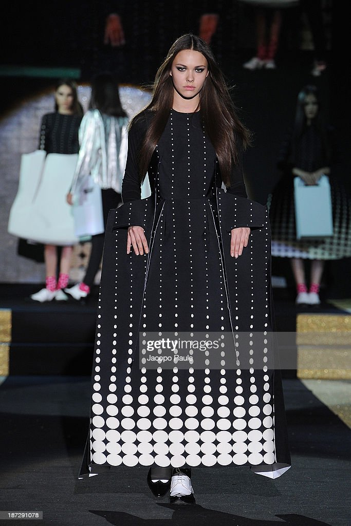 A model walks the runway at Jennifer Belton Fashion Show during the Mittelmoda Special Edition 2013 for Lectra on November 7, 2013 in Milan, Italy.