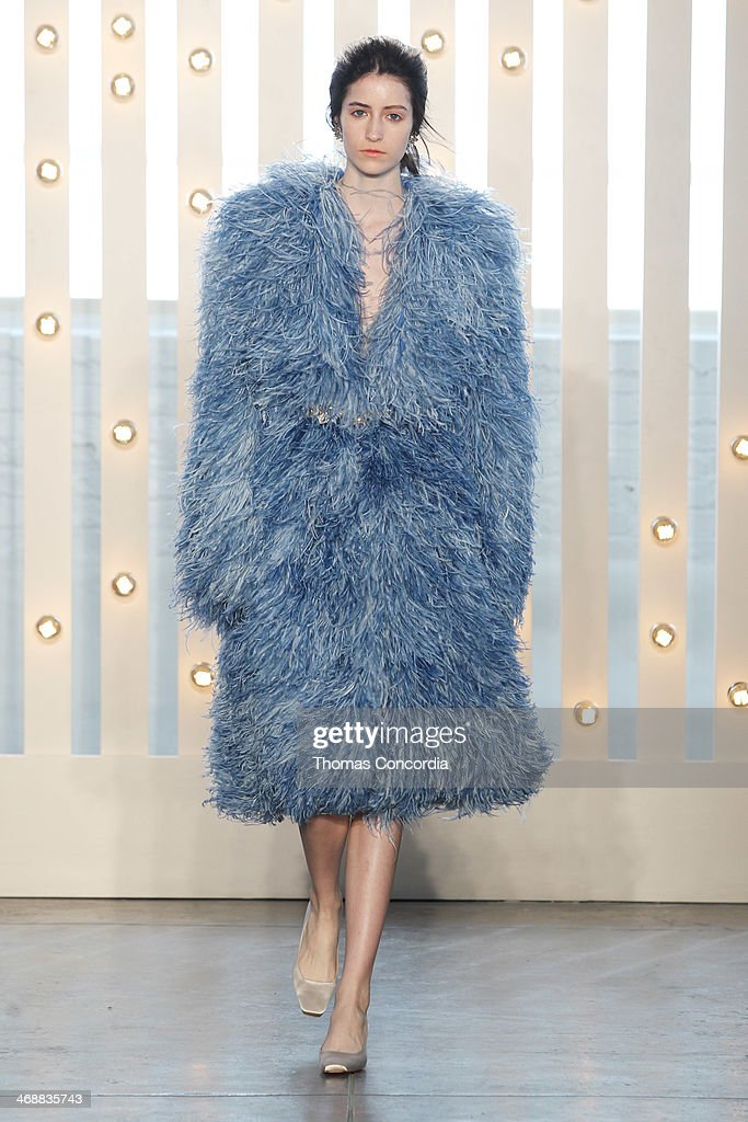 A model walks the runway at Jenny Packham during MercedesBenz Fashion Week Fall 2014 at Industria Superstudio on February 11 2014 in New York City