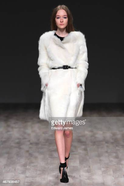 A model walks the runway at Jill Stuart during MercedesBenz Fashion Week Fall 2014 at The Salon at Lincoln Center on February 8 2014 in New York City