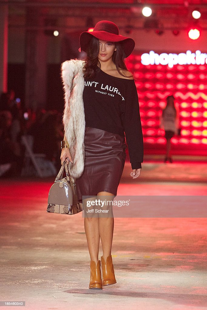 A model walks the runway at Kristin Cavallari Hosts Akira's 11th Annual Fall Fashion Show Featuring Kristin Cavallari By Chinese Laundry on October 20, 2013 in Chicago, Illinois.