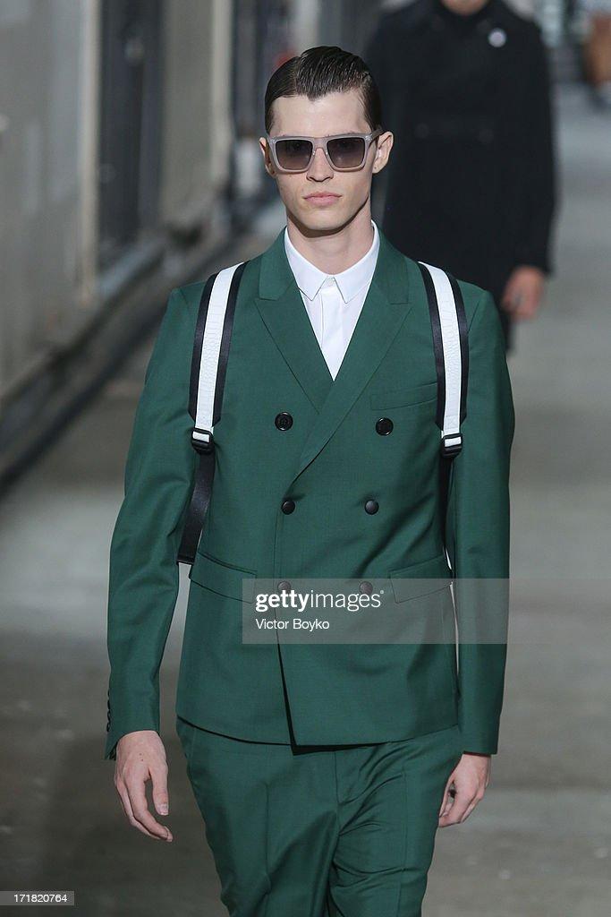 A model walks the runway at Krisvanassche Menswear Spring/Summer 2014 Show As Part Of The Paris Fashion Week on June 28, 2013 in Paris, France.