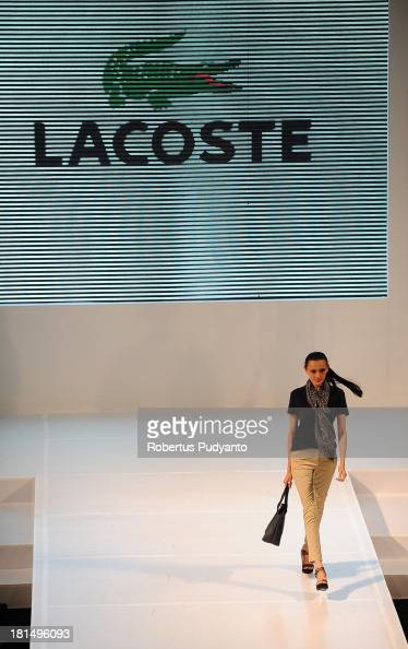A model walks the runway at Lacoste show during Ciputra World Fashion Week on September 21 2013 in Surabaya Indonesia