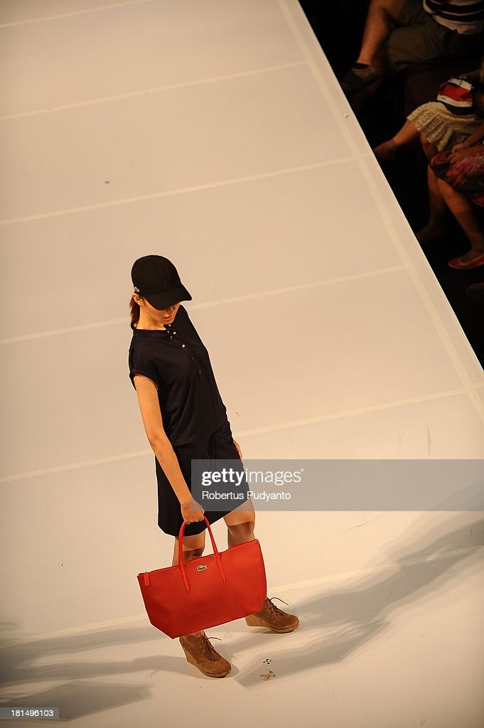 A model walks the runway at Lacoste show during Ciputra World Fashion Week on September 21, 2013 in Surabaya, Indonesia.