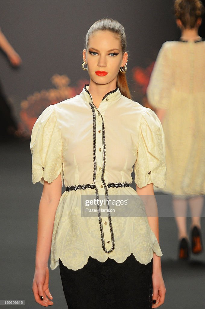 A model walks the runway at Lena Hoschek Autumn/Winter 2013/14 fashion show during Mercedes-Benz Fashion Week Berlin at Brandenburg Gate on January 15, 2013 in Berlin, Germany.