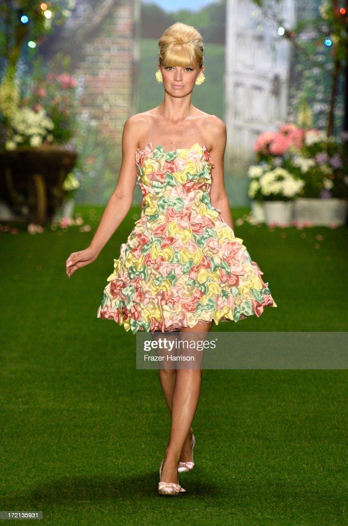 A model walks the runway at Lena Hoschek show during Mercedes-Benz Fashion Week Spring/Summer 2014 at Brandenburg Gate on July 2, 2013 in Berlin, Germany.