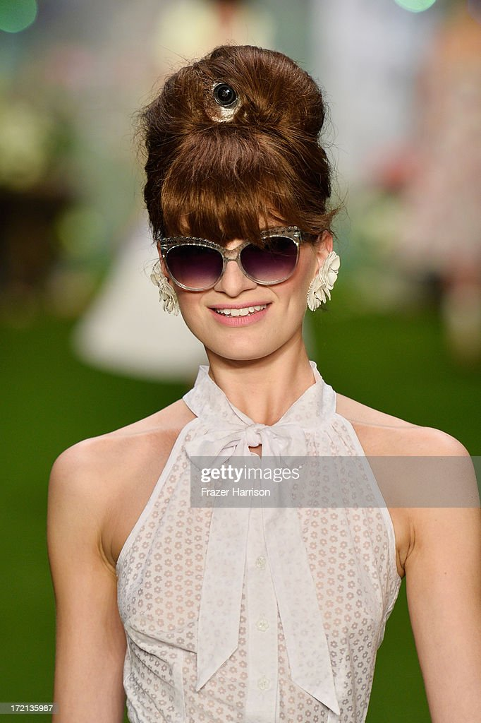 A model walks the runway at Lena Hoschek show during Mercedes-Benz Fashion Week Spring/Summer 2014 at Brandenburg Gate on July 2, 2013 in Berlin, Germany.
