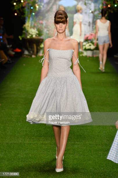 A model walks the runway at Lena Hoschek show during MercedesBenz Fashion Week Spring/Summer 2014 at Brandenburg Gate on July 2 2013 in Berlin Germany