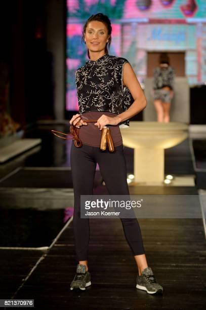 A model walks the runway at MAAJI Runway FUNKSHION Swim Fashion Week at Setai Hotel on July 23 2017 in Miami Beach Florida